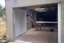 Menuiseries-bsdf.fr-Pleudaniel/ porte de garage sectionnelle latérale/22260 Plouec du trieux